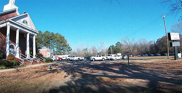 Trucks, trailers and vans lined up in the front parking lot at First Baptist Church in Middleton to receive bulk amounts of boxes for delivery throughout Hardeman County.
