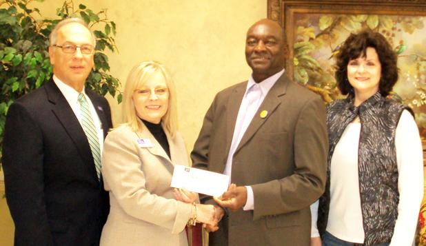 Pictured (l-r): First South Community Bank President Larry Crawford, Vice President/Branch Manager Lora Moore, Vice President of Hardeman Co Imagination Library Monroe Woods, Representative Cathy Mayfield