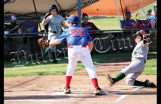 John Baker slides into home for the first run of the game on July 22 against Jackson County National.
