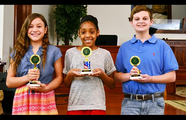 4-H public speaking contest winners fifth grade pictured (l-r): Marissa Mills (first place), MaShante Brown (second place), and Campbell Emerson (third place). Photo by Gary Rodgers