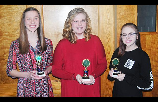 4-5 public speaking contest winners eighth grade pictured (l-r): Maddie Piefer (first place), Josie Ingle (second place), and Lauren Baldwin (third place).