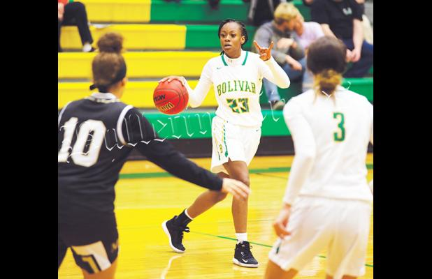 Both Bolivar Central Basketball teams reached the semifinals of the District 15AA tournament with wins on Monday and Tuesday.  Bolivar is hosting the district tournament for the first time since 2003. For more Sports, see A12-13. Photo of Nakidra Champion by Heather Pulse.