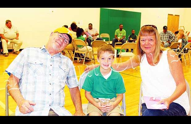Mike and Anita Jacobs joined Travis Gallagher for Grandparent's Day at Bolivar Elementary School.
