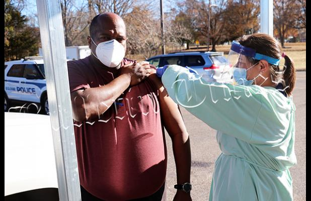 Bolivar Police Chief Mike Jones gets the Moderna COVID-19 vaccine at the Hardeman County Health Department from Melissa Anderson.
