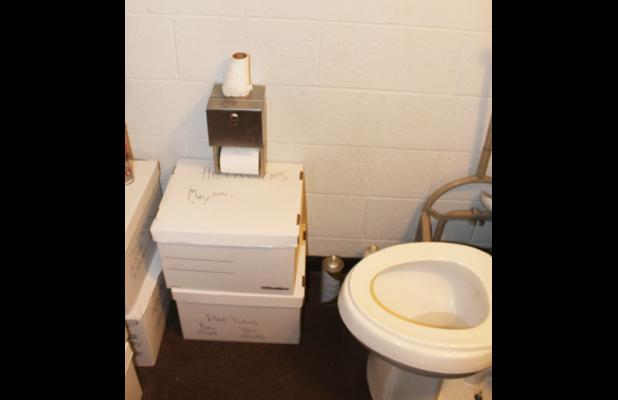 The bathroom, a small room less than the space of a closet, in the administrative office of the Hardeman County EMS, is often times packed with boxes of files and information (due to lack of space) and presents only a small path for employees to use the restroom.
