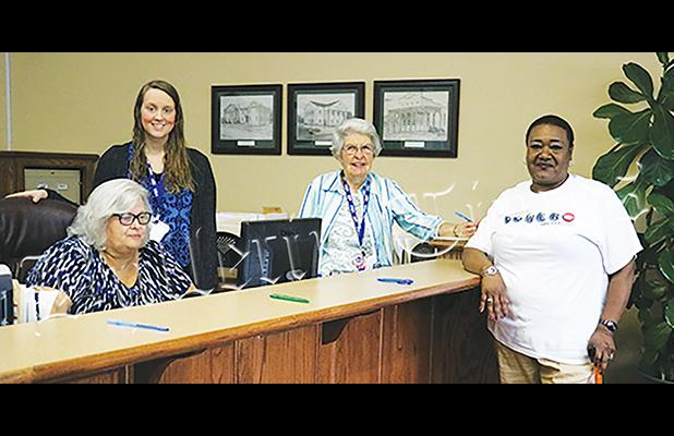 Elaine Woods was the first to vote on May 1. She is joined by (left to right) Hardeman County Administrator of Elections Amber Moore, and election staffers Amy Cleek and Barbara Grant.