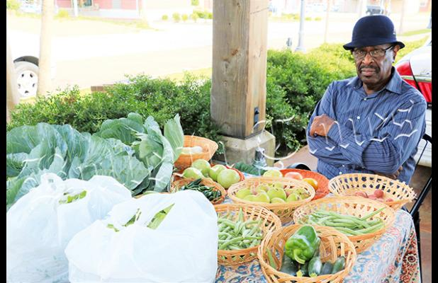 Lester Cox at his stall at the Bolivar Farmers Market by Ginger Tester