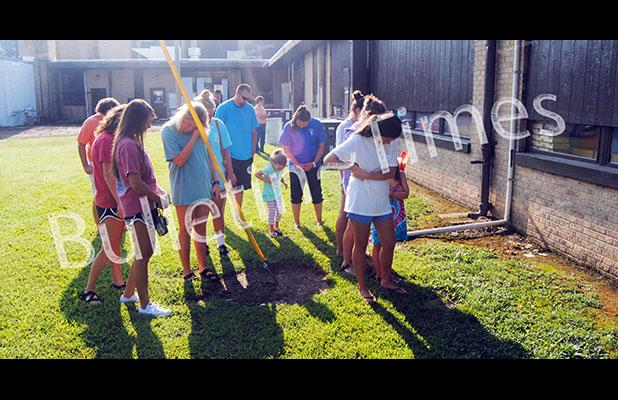 People attending a Back to School Prayer Breakfast at Hornsby Baptist Church on Saturday, August 8, walked around nearby Hornsby Elementary School to pray for students and teachers and for the upcoming school year.