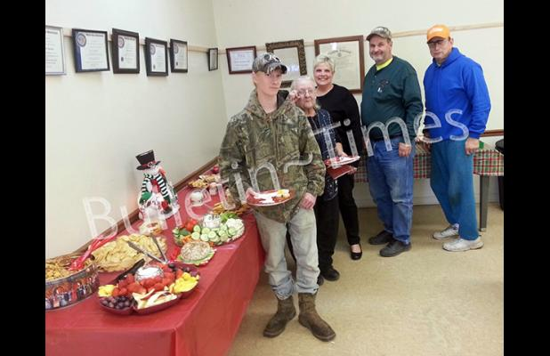 Guests pictured (l-r): Cade Goodwin, Lila Davison, Pat Plunk, Curtis Vandiver, and Terry Parchman prepare to sample some of the hors-d'oeuvres served at the City of Hornsby's open house on Dec. 19. Pat Plunk and Patricia Parchman put together the assortment of fruits, veggies, cheeses, dips, and sweets.