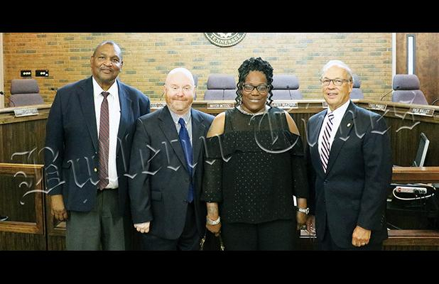 Sworn-in on July 1 were (from left to right) incumbent councilmen Larry McKinnie and Todd Lowe, along with newly-elected councilpeople Carol B. Spinks and Larry Crawford. Photo by Johnny Weems.