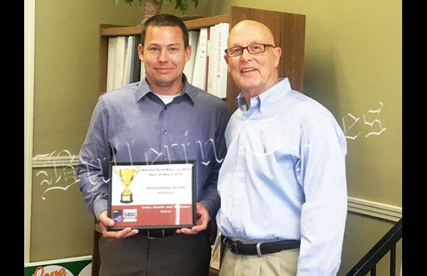 In celebrating National Small Business Week (April 29-May 5, 2018) Joel Newman (right) of the Tennessee Small Business Development Center gave an award to Greg Byers of Unity Health and Wellness Clinic in Bolivar for Outstanding Health Services.