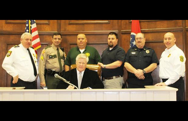 Pictured front, Hardeman County Mayor Jimmy Sain. Back row (l-r) Middleton Police Chief Lynn Webb, Tennessee State Highway Patrol Sgt. Don Velez, Hardeman County Sheriff John Doolen, Hornsby Police Chief Shane Swift, Toone Police Chief Jerry Siler and Bolivar Police Chief Pat Baker.