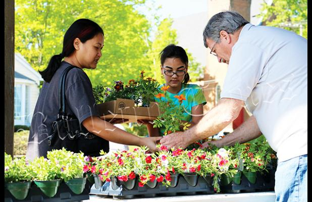 Master Gardener Gary Barrowclough assists customers at their annual plant sale on April 28.  Story and photos by Ginger Tester.