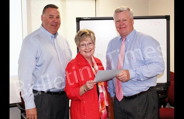 Photo left to right: Hardeman County Superintendent of Schools Warner Ross II, Gear Up Coordinator Dr. Dorrie Powell, and Sain.