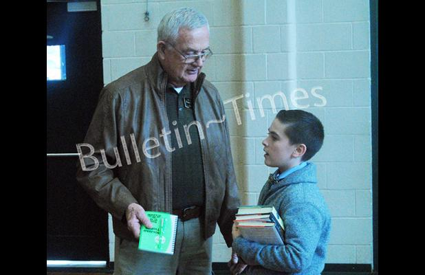 Bolivar Mayor Barrett Stevens speaks with BMS student Noah Cody about his love of reading during the school's book giveaway day on Friday, March 4.