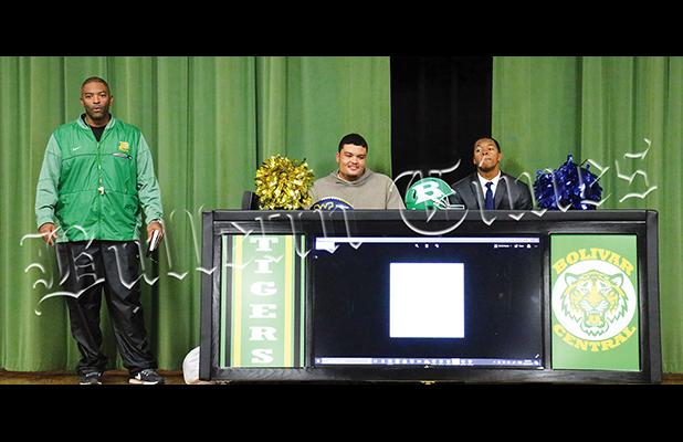 Mays (left), and Lowe (right), with Bolivar Central Head Coach Woodrow Lowe, were honored in a ceremony, which included them receiving their high school diplomas on December 11. Both signed the official paperwork at home.