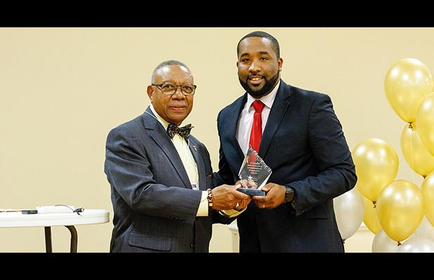 McTizic (right) is pictured accepting the African American Conference Emerging Leader Award from Evelyn Robertson Jr., WestStar class of 1997.