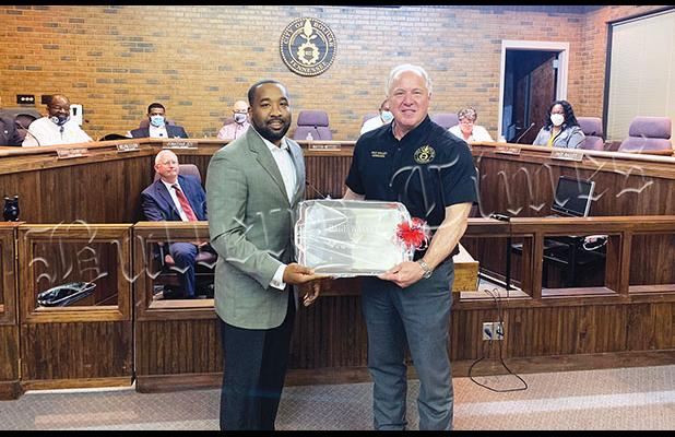 Bolivar Mayor Julian McTizic presents Walley with a silver platter to commemorate his time as a city councilman.