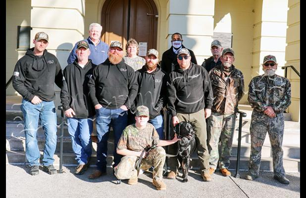Photo: Hardeman County Mayor Jimmy Sain, Toone Mayor Jackie Kelley, Bolivar Mayor Julian McTizic, Larry Leathers, James Howell, Emma McAthur, Hoot and Diesel join the group from Fort Bragg. Photo by Sarah Rice.