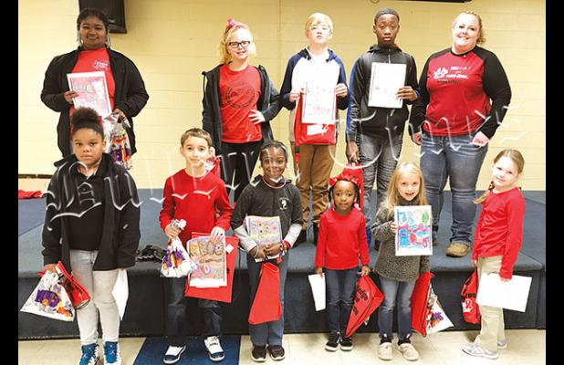 Coloring Contest Winners left to right back row: Taniya Starks, Maci Slavens, Josef Slavens, Awarion Barnett, Officer Howell. Front row: Taziayha Simon, Austin Malena, Carlee Clayborne, Madison Thomas, Kassi Duncan