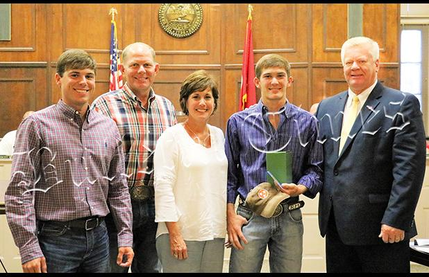 Ross with parents Jim and Vicky Mitchell, brother Clay and Hardeman County Mayor Jimmy Sain. Brother Clay is the #7 ranked rodeo cowboy in Canada.  Photo by Ginger Tester.