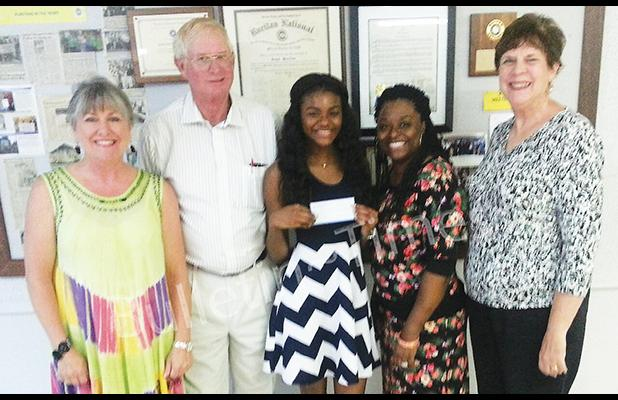 Photo (left to right): Kandy Shackelford, Executive Director Hardeman County Chamber of Commerce, Earl Smith, Ruritan President, Dakedra Mason, scholarship recipient, Dekita Cheairs, and Mary Jo Gordon, Chairman of the Ruritan Scholarship Committee.