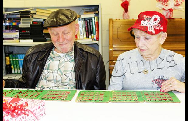 """Ken and Myrtie Schlueter spend the morning playing Bingo at the Bolivar Senior Center just as they've done most Tuesday and Thursday mornings over the past 10 years. Myrtie says, """"Quality time together makes for a long and happy 61 years of marriage""""."""