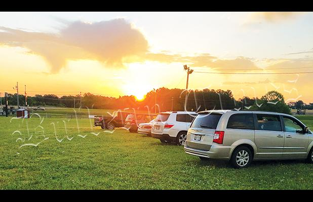 Dozens of cars parked on the grounds at the AgriBusiness Center in Hardeman County on the morning of May 3 for a Community-wide church sunrise church service.