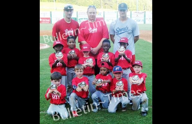 Members of The Gym and their caches proudly display their first place trophies after defeating David Dorris Logging 12-9 in the championship game of the Dizzy Dean 5-6 years old Division on Tuesday, June 9.