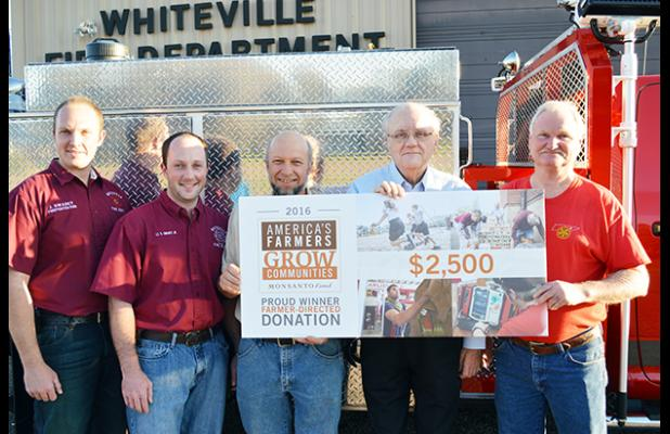 Photo left to right: John Swarey, Jr. Swarey, Samuel Swarey, Mayor James Bellar, Fire Chief Ernie Burkeen.