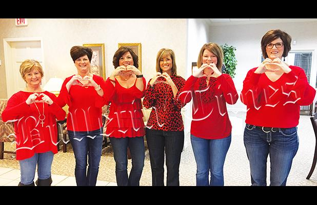 The ladies of Centennial Bank wore red on Friday, February 7 in observance of Go Red Day, a day designed to bring awareness of heart disease and stroke.