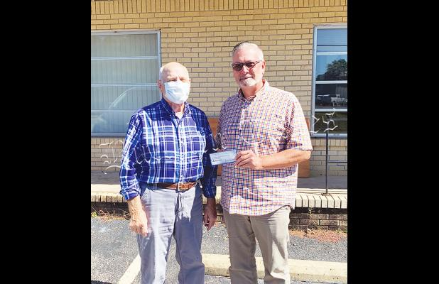 Photo left to right: James Burchfield of Bolivar Civitan and Nehemiah Project Board of Directors President Johnny Weems.