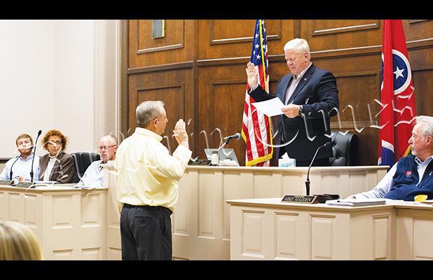 Hardeman County Mayor Jimmy Sain swears in DeBerry.