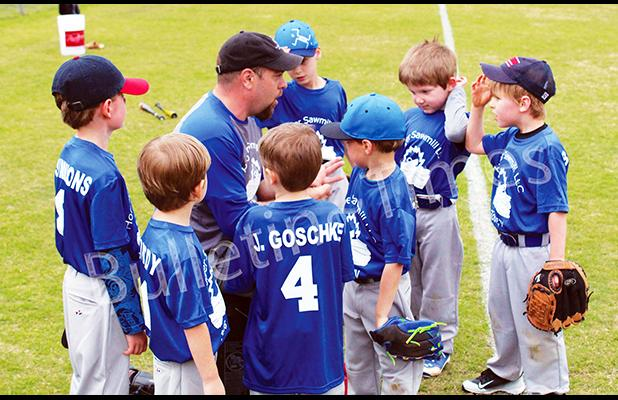 Photo: Casey Swift of Hooper Sawmill talks with his players before the first game of the season.