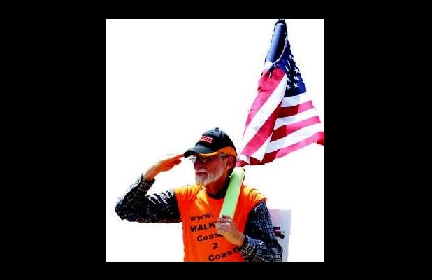 Pastor and Vietnam Veteran Walter McGill is walking from North Carolina to California on a mission. While carrying the American fl ag and saluting motorists, McGill said he is bringing awareness to the 10 Commandments, the love of Jesus, and unity among Christians.