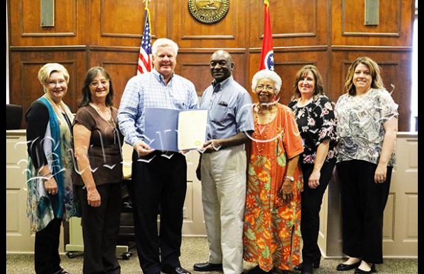 Photo left to right: Dr. Dorrie Powell, Jackie Hickey, Sain, Monroe Woods, Gladis Thomas, Becky White, Cynthia Scott.