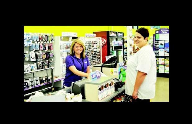 Amber Bailey assisting customer Carla Vaughn.