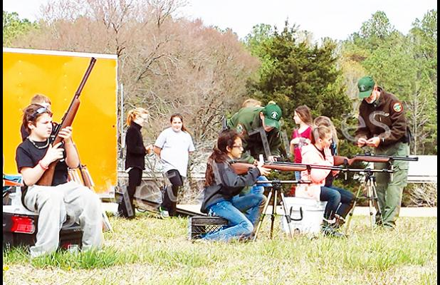 Students use the TWRA shooting simulator. Photo and story by Calley Overton.