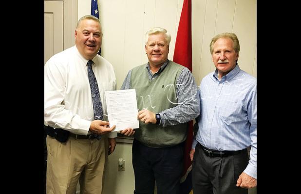 Hardeman County Mayor Jimmy Sain (center) with Hardeman County Superintendent of Schools Warner Ross II, and Deputy Director Bobby Doyle.