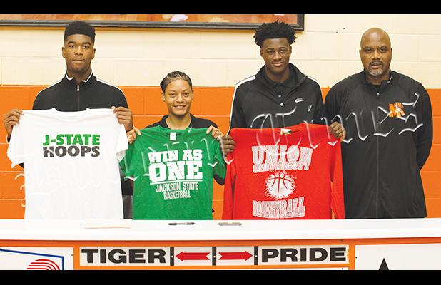 Middleton High School celebrated three signees on April 17 as (left to right) Kelan Jones and Sequoia Warren signed with Jackson State and Tylandrius Parks signed with Union University. They are pictured with Middleton Head Basketball Coach James Burkley.