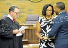 Bolivar Mayor McTizic takes the oath of office from Hardeman County General Sessions Judge Boyette Denton as wife Demetria looks on. Photo by Hannah Pattat.