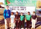 Bolivar Elementary and Bolivar Middle School received new signs for their campuses from the Hardeman County Schools. At Bolivar Elementary, school principal James Rutherford poses with students.