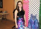 """Pictured, Amber Bailey tries on one of the dresses on sale at the """"A Second Dance"""" prom dress sale."""