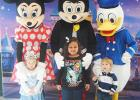 Laynee JoAnna (daughter of Cassie Holmes), Mya Overton (daughter of Lindsey Overton), and Maddox Morein (son of Kim and David Morein) pose for a picture with Minnie Mouse, Mickey Mouse and Donald Duck.