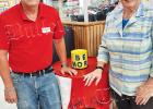Jimmy Howell, assistant manager of Bolivar's Food Giant, and Stephanie Middleton recently set up a bin for food donations near the front of the store.