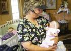 Sherri Chance prepares reborn Julie for a trip to Pine Meadows.