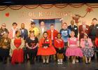 "The cast of ""Murder at Kool Kat High"" Seated (l-r): Cecilia (CC) Hadley (Rah Rah La Roux), Gladis Thomas (Ruby Tuesday), Demetria McTizic (Lollipop), Ginger Hillman Crowe (Antoinette FUNachello), Ashley Trainum (Veronica Von Pond), Johnbernae Hudson (Trixie Dixie), Autumn Trainum (Babsi Doll), Denise Estes (Miss Connie Brooks), Mica Shelly Harris (Bambi La Bomba). Standing (l-r): Wanda Young (Director), Stacie Grantham (Flash O'Hara), Tim Moss (Jamie Dean), Gary Byers (Elvis Pretzel), Illya Higgs, (Greased"