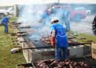 Rotary Club members cooked the chickens near El Ranchito in Bolivar.