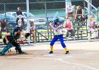 Chloe Griffin of Whiteville hits as Madison Boatwright of Bolivar catches in the first inning of their game on September 19. Bolivar beat Whiteville 13-0.