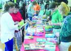Students line up at BMS to select their own hard back book thanks to a $5,000 grant from best selling author James Patterson during the school's Book giveaway day on Friday March 4.